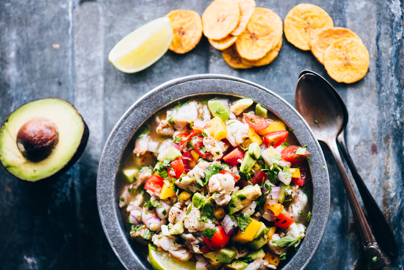 Easy Shrimp Ceviche is the perfect protein-packed, fresh meal. It's great when the weather gets hot. I load mine with mango, jalapeño, shrimp, and fresh citrus juices. It's paleo, gluten-free, and whole30 friendly. Learn how to make it now! | StupidEasyPaleo.com