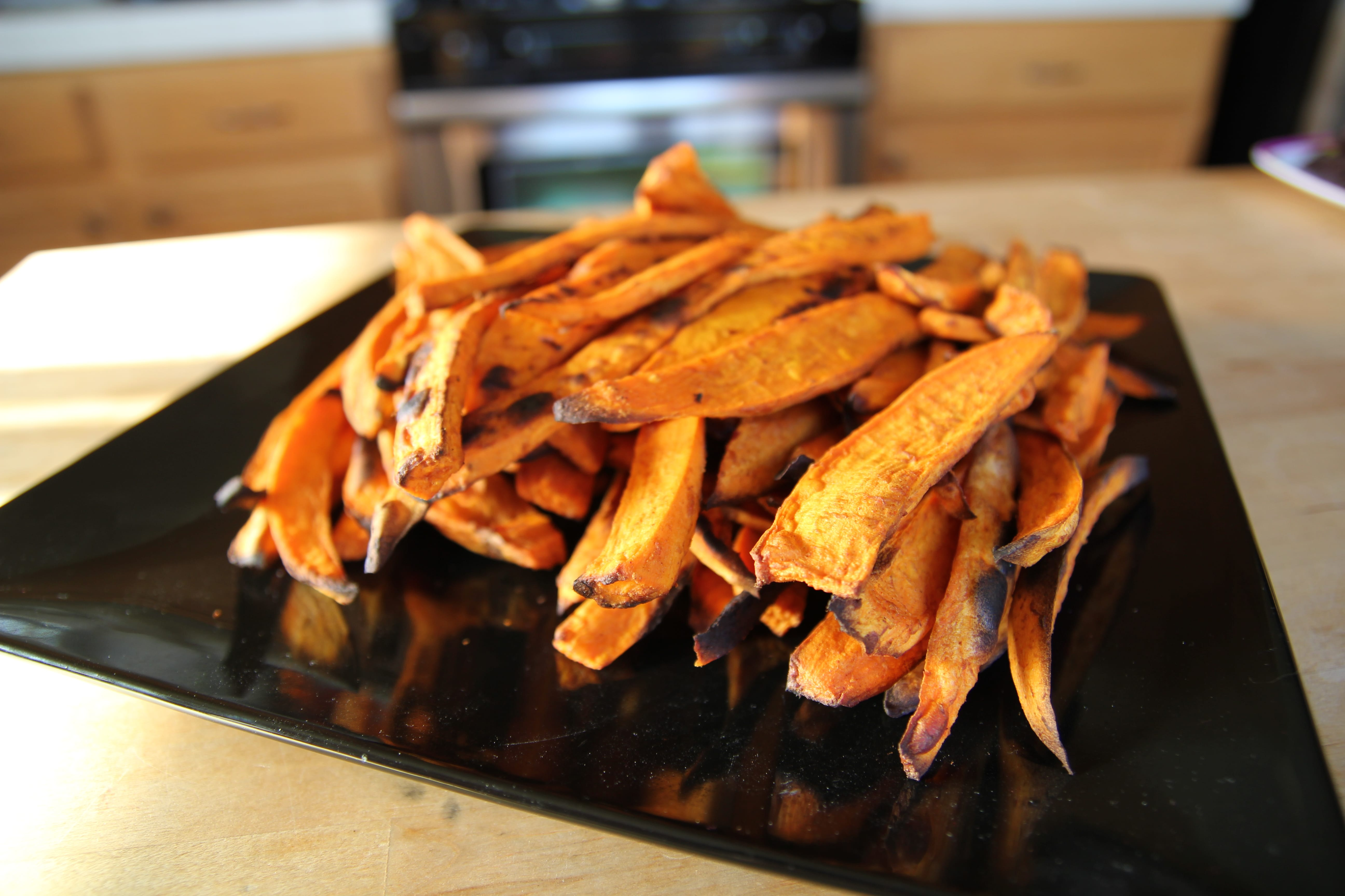These Paleo Sweet Potato Fries are coated with tangy stone ground mustard and oven-baked to perfection. Gluten-free and whole30 friendly.