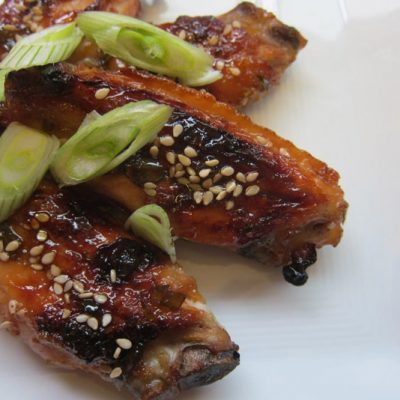 Paleo Orange Ginger Chicken Wings will make a sweet-spicy addition to your next party. These are gluten-free and paleo. Learn how here!
