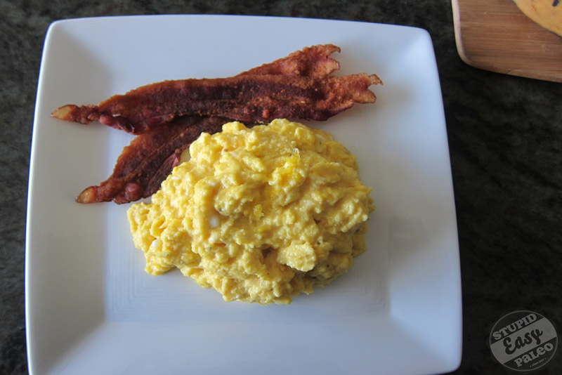 Making eggs like this will be well worth the extra minutes of investment. The result is perfect scrambled eggs, you'd swear there's cheese in them. | StupidEasyPaleo.com