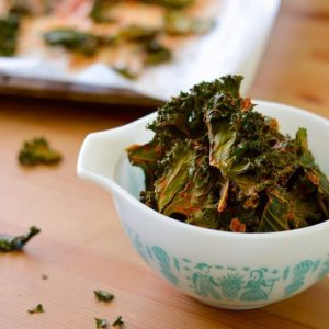 Paleo Kale Chips are baked, not fried! These gluten-free kale chips taste just like nacho cheese. See how easy it is to make them!