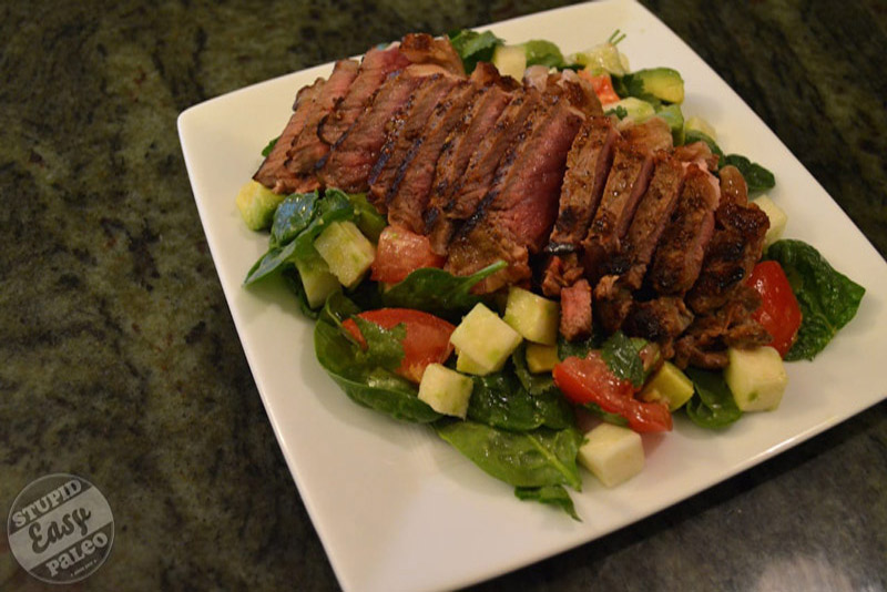 Make this vibrant and delicious Cinco de Mayo Steak Salad recipe, a healthy way to celebrate the flavors of Mexico! | StupidEasyPaleo.com