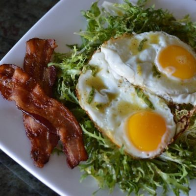 Frisee Salad with Bacon and Eggs is a great way to start your day. It comes with a tangy dressing. This dish is paleo, gluten-free & whole30. | StupidEasyPaleo.com