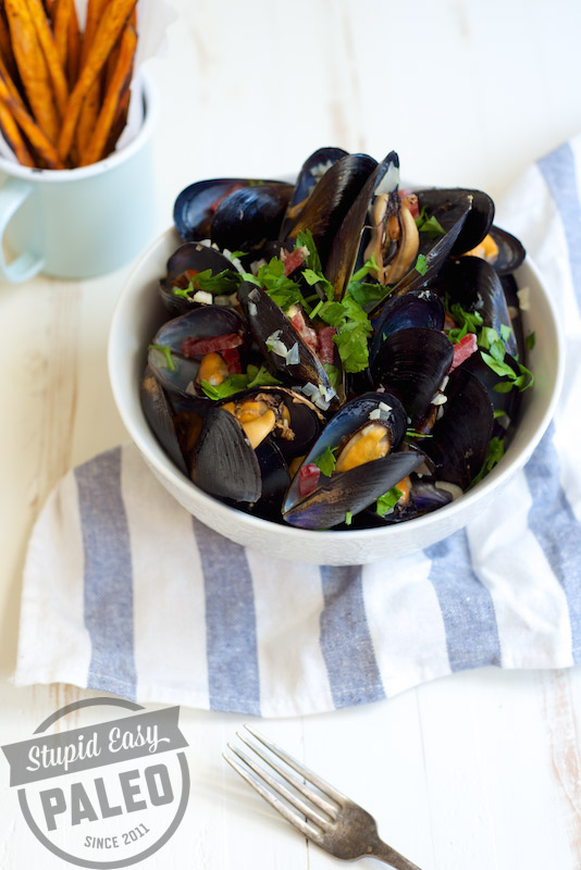 Mussels & Sweet Potato Fries looks fancy dancy, but this simple meal is packed with flavor. Tender mussles pair with crispy sweet potato fries. | StupidEasyPaleo.com