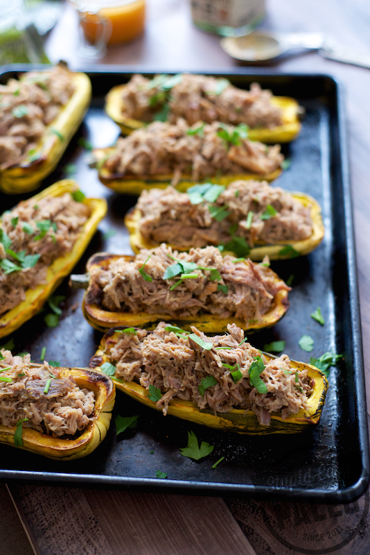 This Paleo Pulled Pork Stuffed Squash is perfect for game day appetizers or as a hearty dinner with a side salad! | StupidEasyPaleo.com
