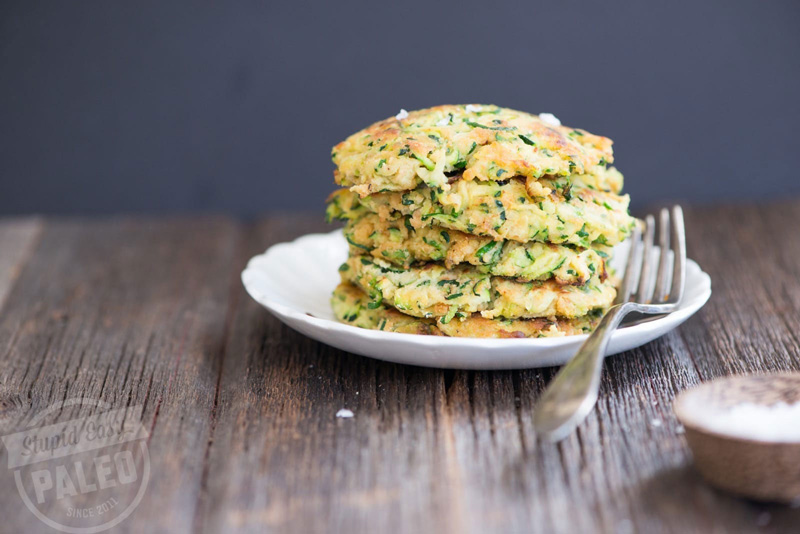 This Paleo Zucchini Fritters Recipe is gluten-free and simple to make. The key is getting the zucchini dry enough. Learn how! | stephgaudreau.com
