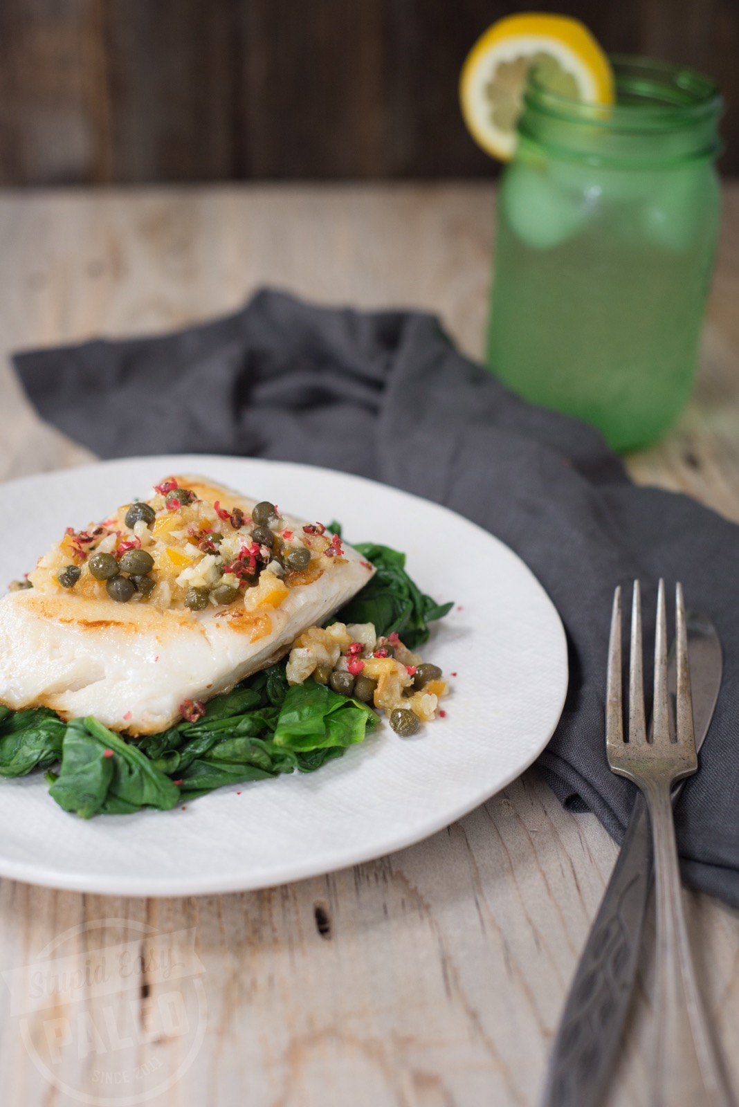 Make this delicious Pan-Fried Haddock with Lemon & Capers Recipe for a quick weeknight dinner. Paleo & Whole30-friendly! | StupidEasyPaleo.com