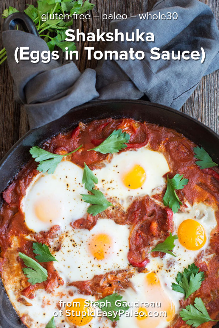 Make this one-skillet Shakshuka recipe for your next weekend breakfast. Eggs are gently nestled in a lightly spiced tomato sauce and baked!   StupidEasyPaleo.com