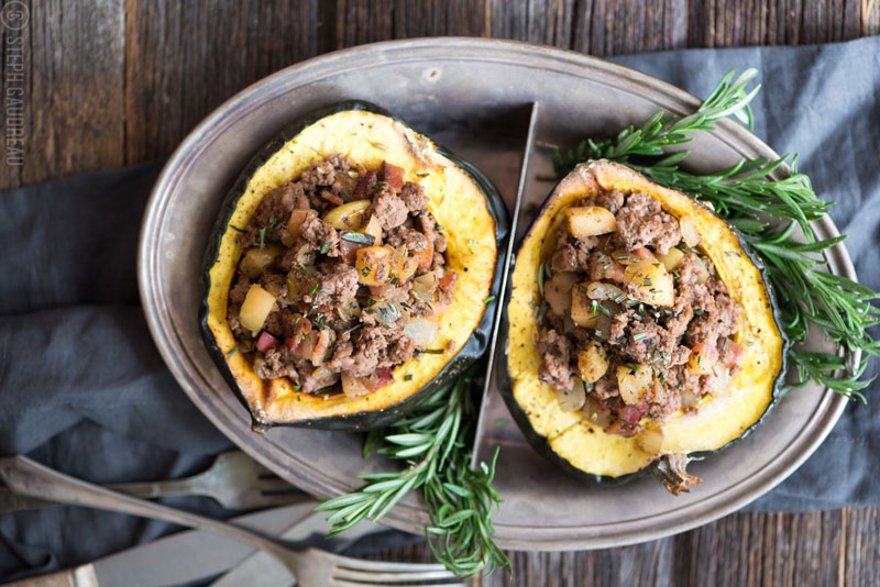 Paleo Stuffed Acorn Squash has all the flavors of fall. Sweet apple, savory sausage, and lots of delicious herbs...it takes kind of like stuffing! It's paleo, gluten-free, and whole30 friendly. Get the recipe now! | StupidEasyPaleo.com