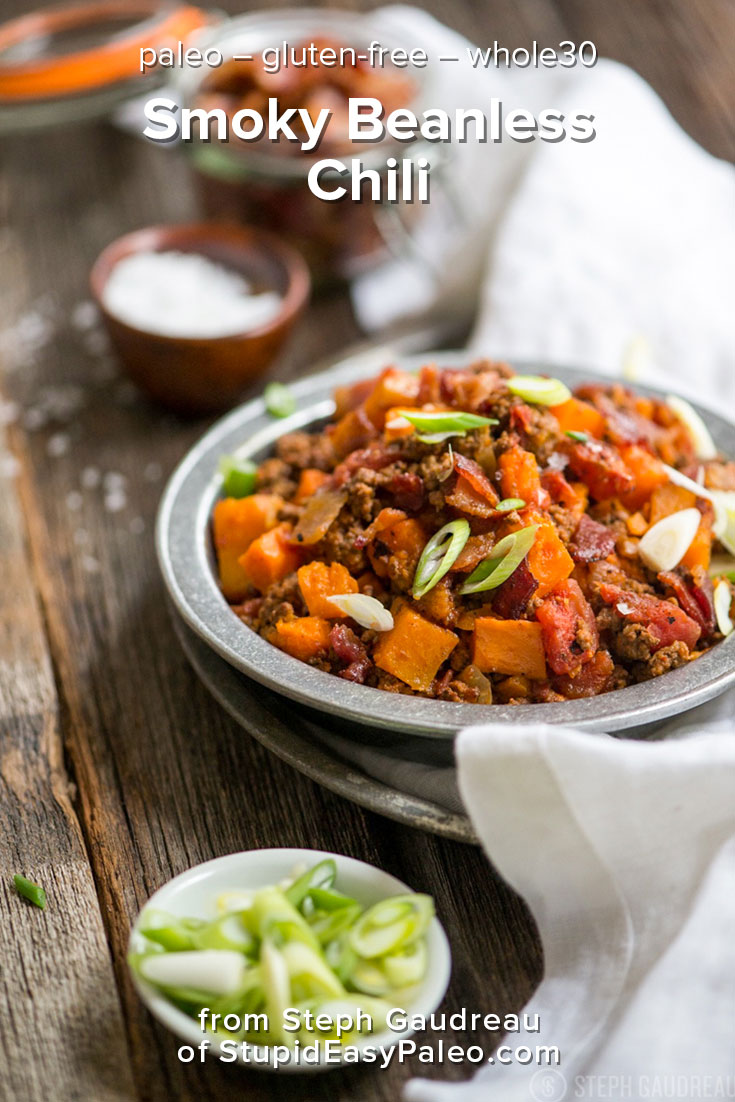 This paleo & gluten-free Smoky Beanless Chili Recipe has smoky bacon, ground beef, and a little bit of sweetness from sweet potato and butternut squash. | StupidEasyPaleo.com