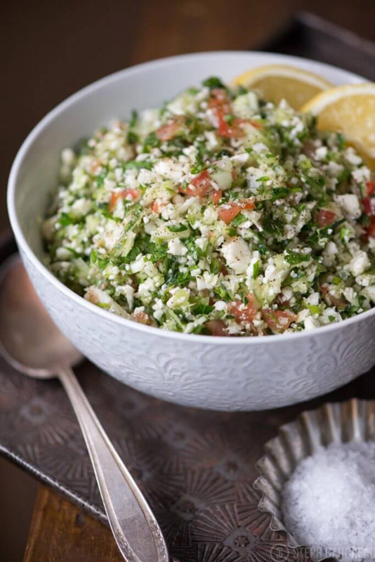 This Grain-Free Tabbouleh Recipe is perfect as a summery side dish or to bring to a cookout! It's chock full of healthy veggies!   StupidEasyPaleo.com