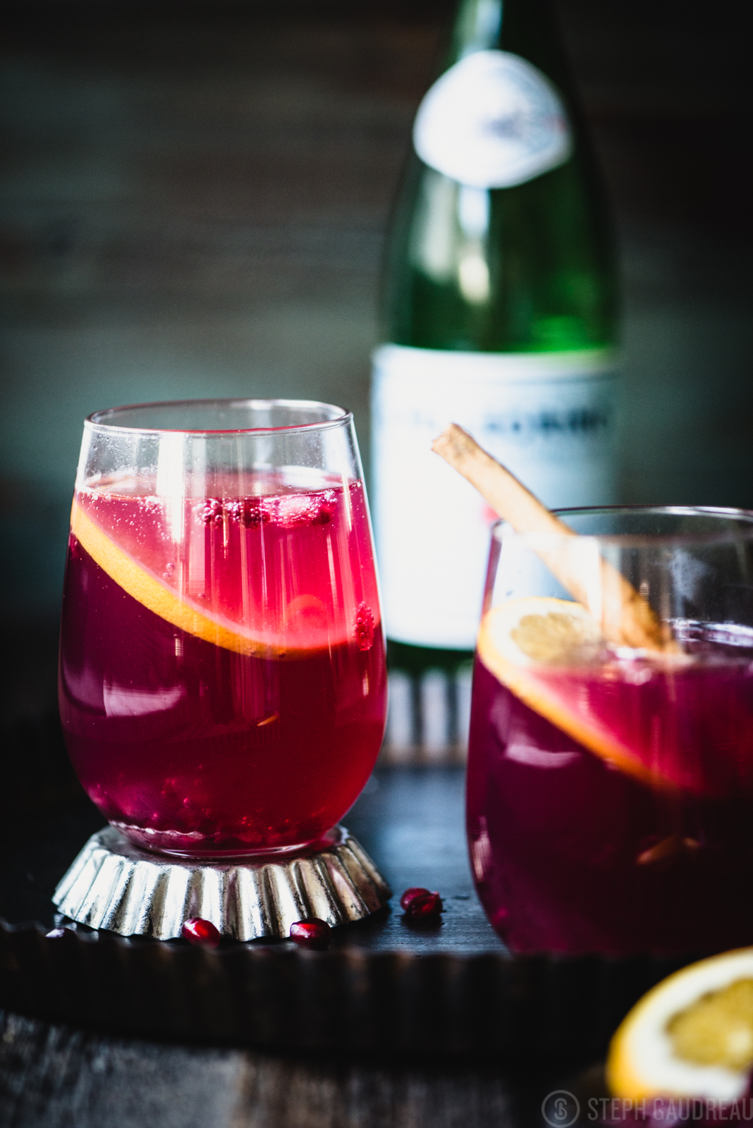 This Pomegranate Spritzer is the perfect way to celebrate the holiday. Warm spice-infused pomegranate juice is topped with sparkling water. | StupidEasyPaleo.com