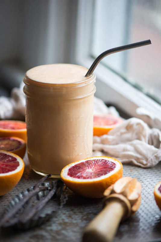 The classic Orange Julius, a frosty, creamy drink just got a totally healthy makeover with added protein, whole fruits, and healthy fat. | StupidEasyPaleo.com