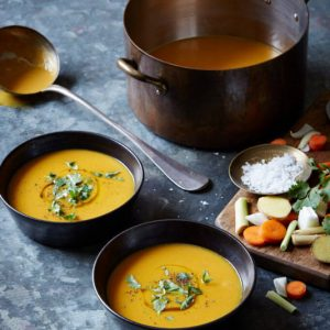 Make this Lemongrass Ginger Carrot Soup recipe with warming spices and gut-healing bone broth for a perfect winter pick-me-up. | StupidEasyPaleo.com
