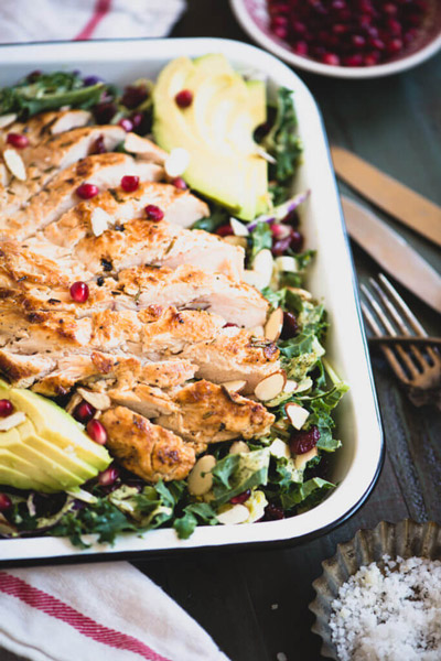 Make this Market Salad with Lemon Chicken recipe for a super-tasty lunch. Features juicy chicken, healthy greens, and crunchy toppings.   StupidEasyPaleo.com