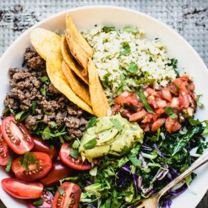 My Bitchin' Bowl is the ultimate in easy dinners, and it's super healthy. Seasoned ground beef, cauli rice, and guacamole make it delish! | StupidEasyPaleo.com