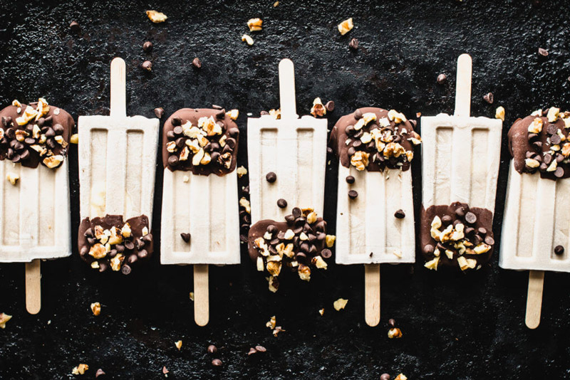 Kick summer off right with these Chocolate Banana Popsicles! They're dairy-free, paleo-friendly and so dang simple to make!| StupidEasyPaleo.com
