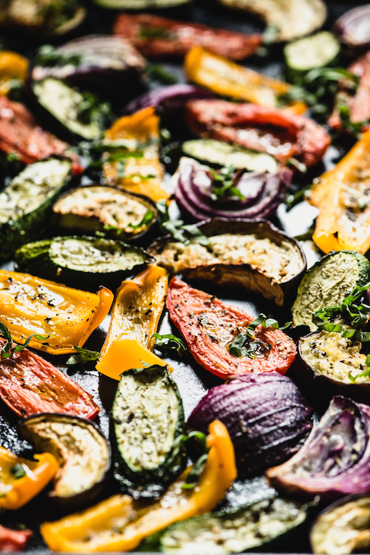 Super easy and flavorful Roasted Mediterranean Veggies will perk up your dinner plate in no time flat. Tomatoes, zucchini, eggplant & more! | StupidEasyPaleo.comSuper easy and flavorful Roasted Mediterranean Veggies will perk up your dinner plate in no time flat. Tomatoes, zucchini, eggplant & more! | StupidEasyPaleo.com