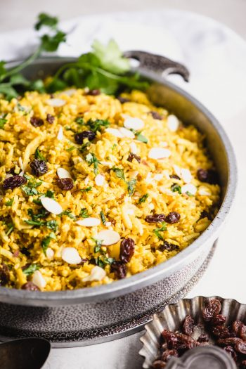 cauliflower rice with curry powder, almonds, and raisins