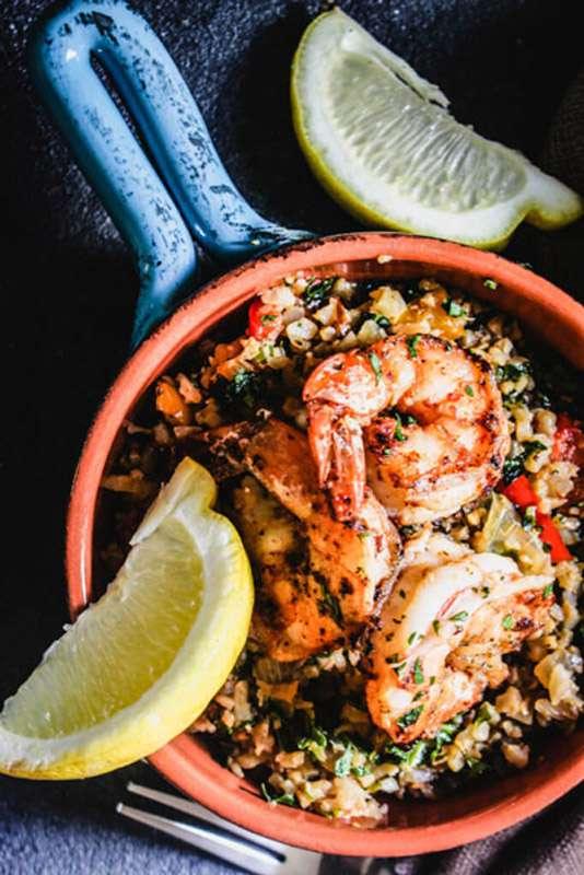 This super scrumptious Lemon Garlic Shrimp with Cauliflower Rice recipe is a perfect gluten-free weeknight dinner that's big on flavor! | StupidEasyPaleo.com