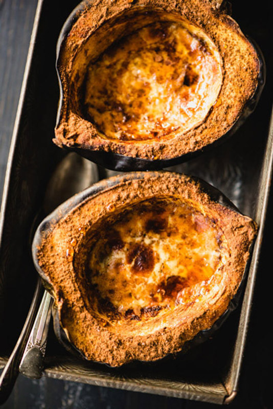 Paleo Baked Acorn Squash is so simple to make, healthy & has all your favorite fall paleo flavors. Plus, it's gluten-free & Whole30-friendly.   StupidEasyPaleo.com
