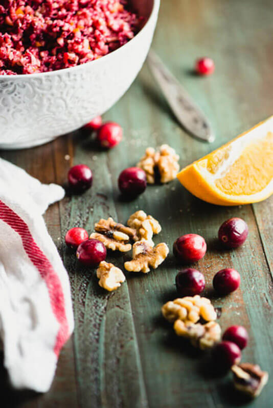 This Cranberry Orange Relish with Walnuts recipe takes 5 minutes to make & tastes like Thanksgiving! Refined sugar-free, paleo, and vegan. | StupidEasyPaleo.com