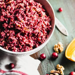 This Cranberry Orange Relish with Walnuts recipe takes 5 minutes to make & tastes like Thanksgiving! Refined sugar-free, paleo, and vegan.   StupidEasyPaleo.com