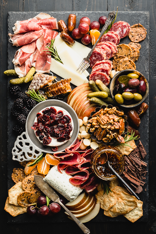 Wow everyone at your next party with the best ever Gluten-Free Charcuterie Board! Get my template and adjust to any needs including make it paleo-friendly or dairy-free.   StupidEasyPaleo.com
