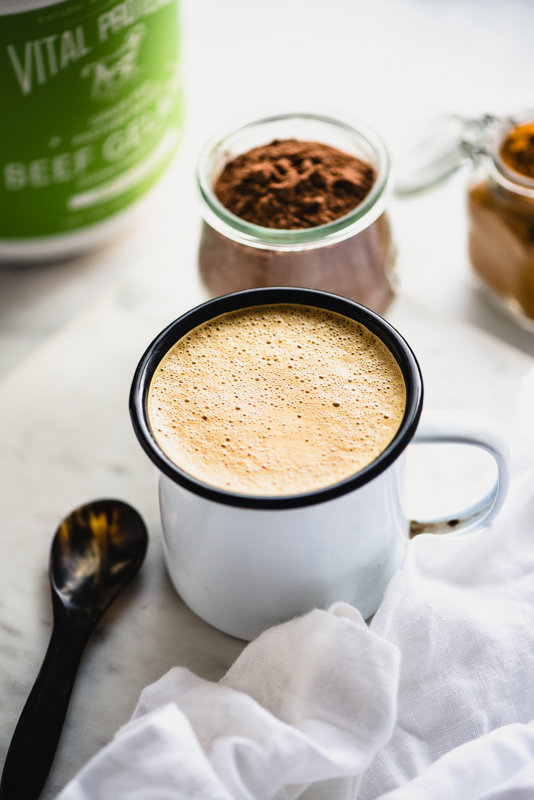 My dairy-free Kicked Up Hot Chocolate is packed with superfood ingredients like gelatin, cacao, and turmeric. Healthy, tasty & paleo...win! | StupidEasyPaleo.com