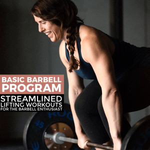 woman holding a barbell about to deadlift