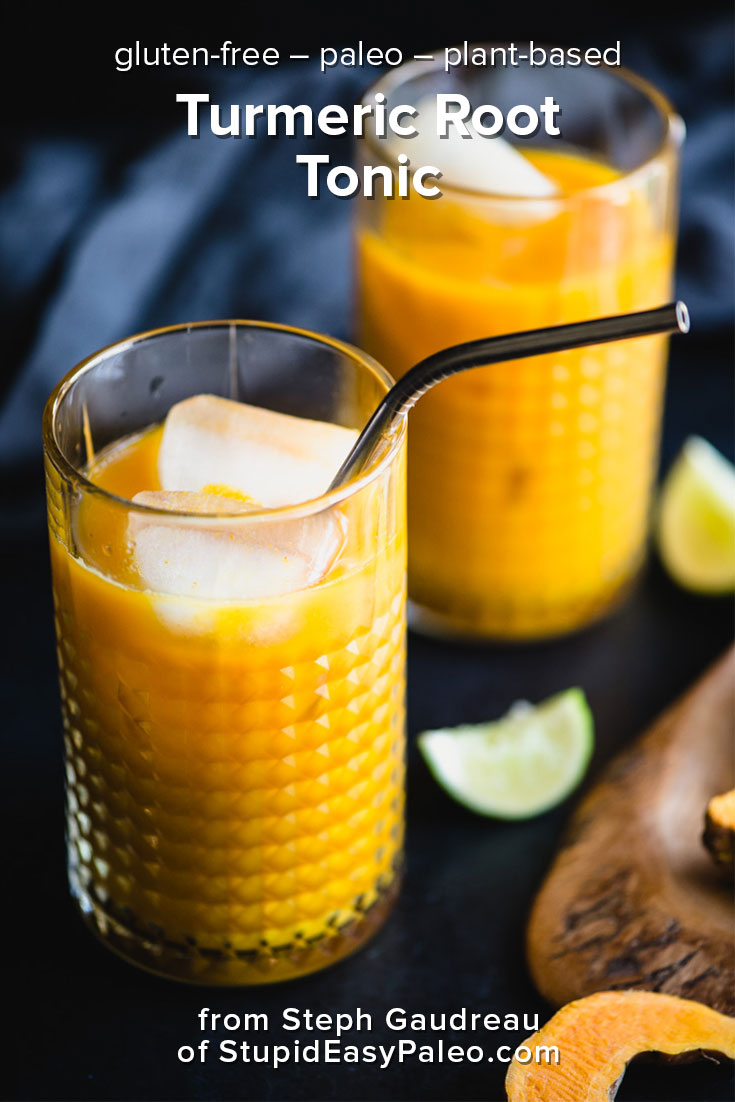 turmeric root tonic, a bright orange drink, with ice in glasses and a metal straw