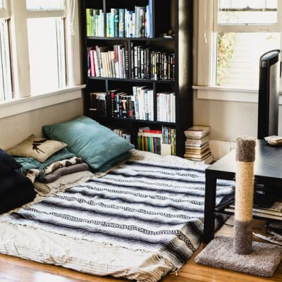 "Couchless living may not be ""normal"" in our culture, but we love it. Learn tips for going couchless, the pros and cons, and why we got rid of our couch in this post. 