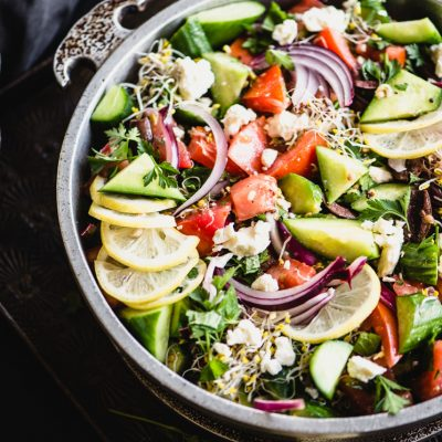healthy greek salad with tomato, cucumber, onion and lemon