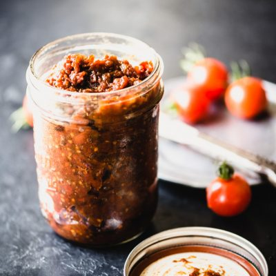 Summer Tomato Jam is a perfect way to use up the bounty of fresh garden tomatoes. It's the perfect blend of sweet and savory with a little spice for good measure. Spread it on gluten-free toast and top with an egg for a delicious breakfast bite. Paleo and gluten-free. | StupidEasyPaleo.com
