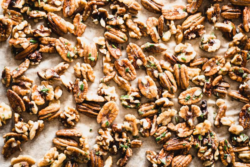 Make these sweet and savory Candied Pecans and Walnuts with Rosemary for your holiday party or charcuterie board. Absolutely delicious and simple to make! | StephGaudreau.com