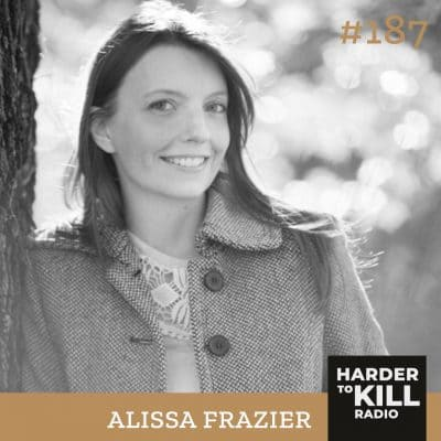 Alissa Frazier is a white woman with brown hair wearing a tweed jacket