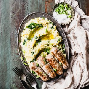 Bangers and Mash is the food equivalent of a snuggly Irish wool blanket! This adaptation features gluten-free sausage and buttery mash on the side.   StephGaudreau.com