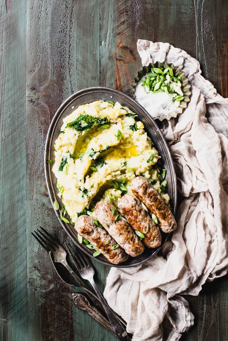 Bangers and Mash is the food equivalent of a snuggly Irish wool blanket! This adaptation features gluten-free sausage and buttery mash on the side. | StephGaudreau.com