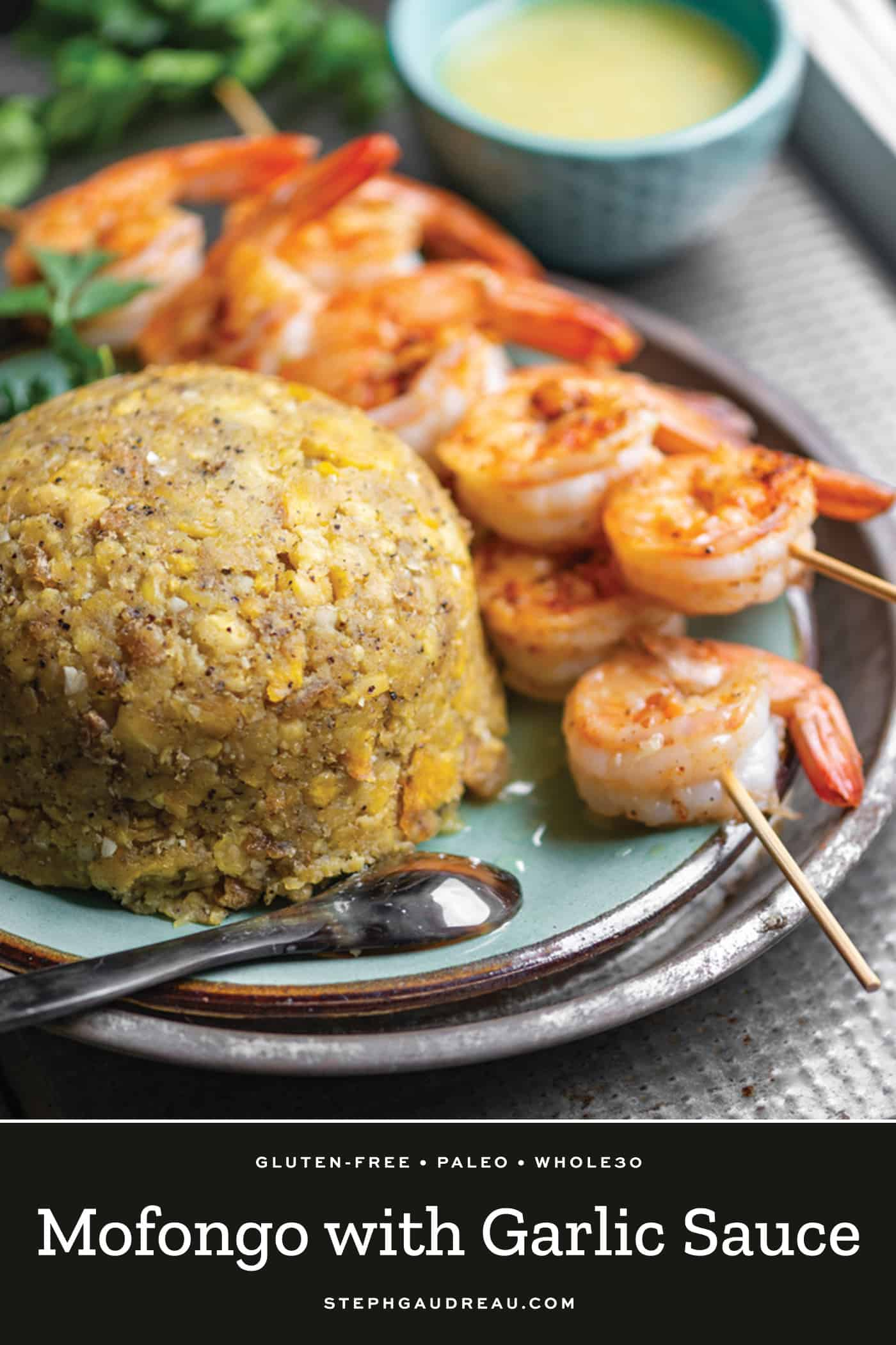 scoop of mofongo on a plate with shrimp and garlic sauce