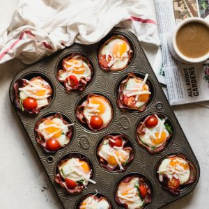 muffin tin with ham and egg cups