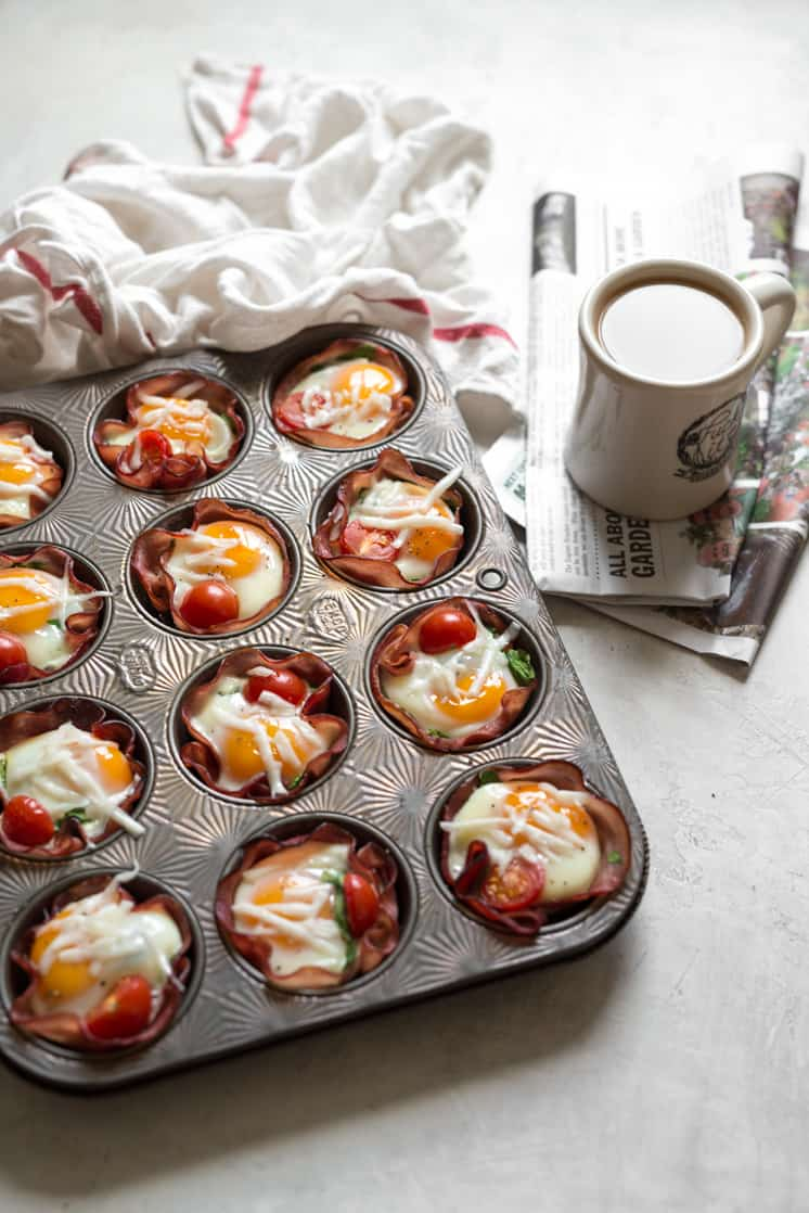 breakfast of egg cups on a table with coffee