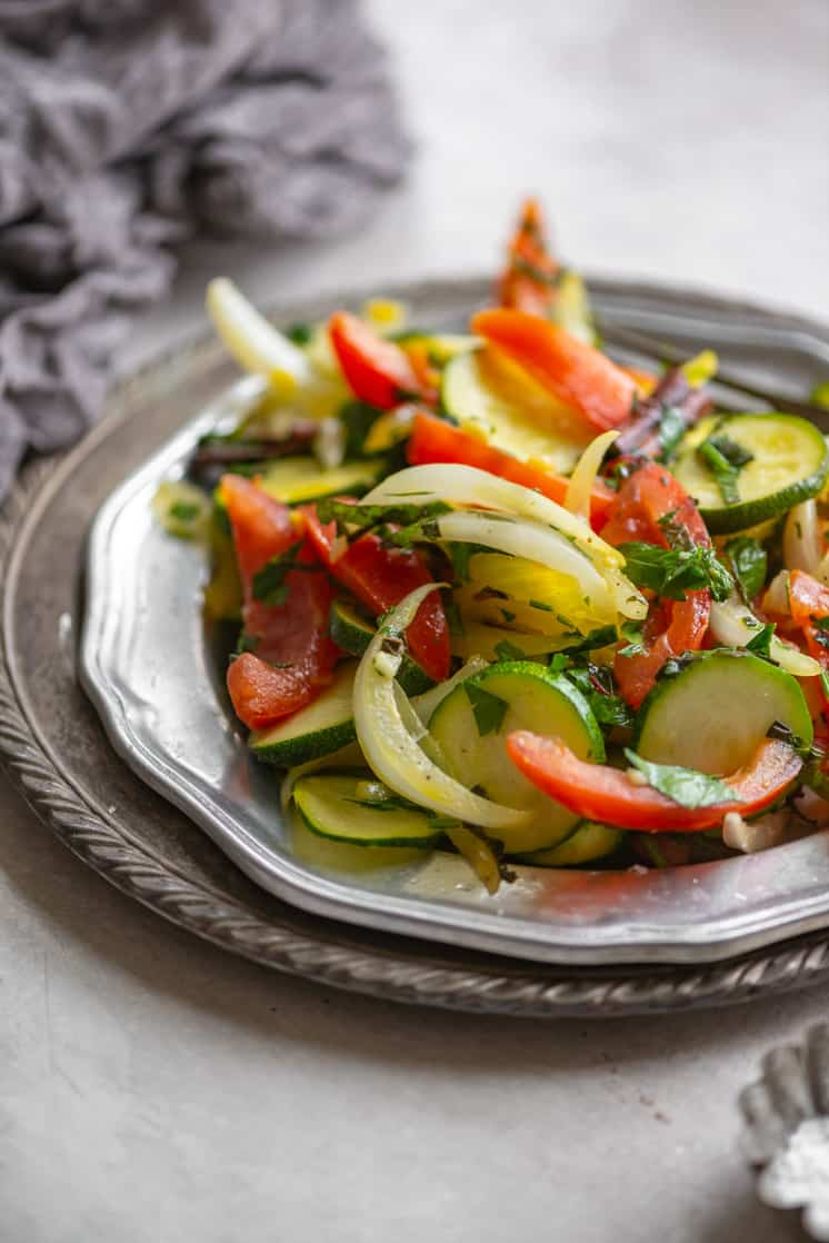 lightly cooked zucchini and tomato made into a salad