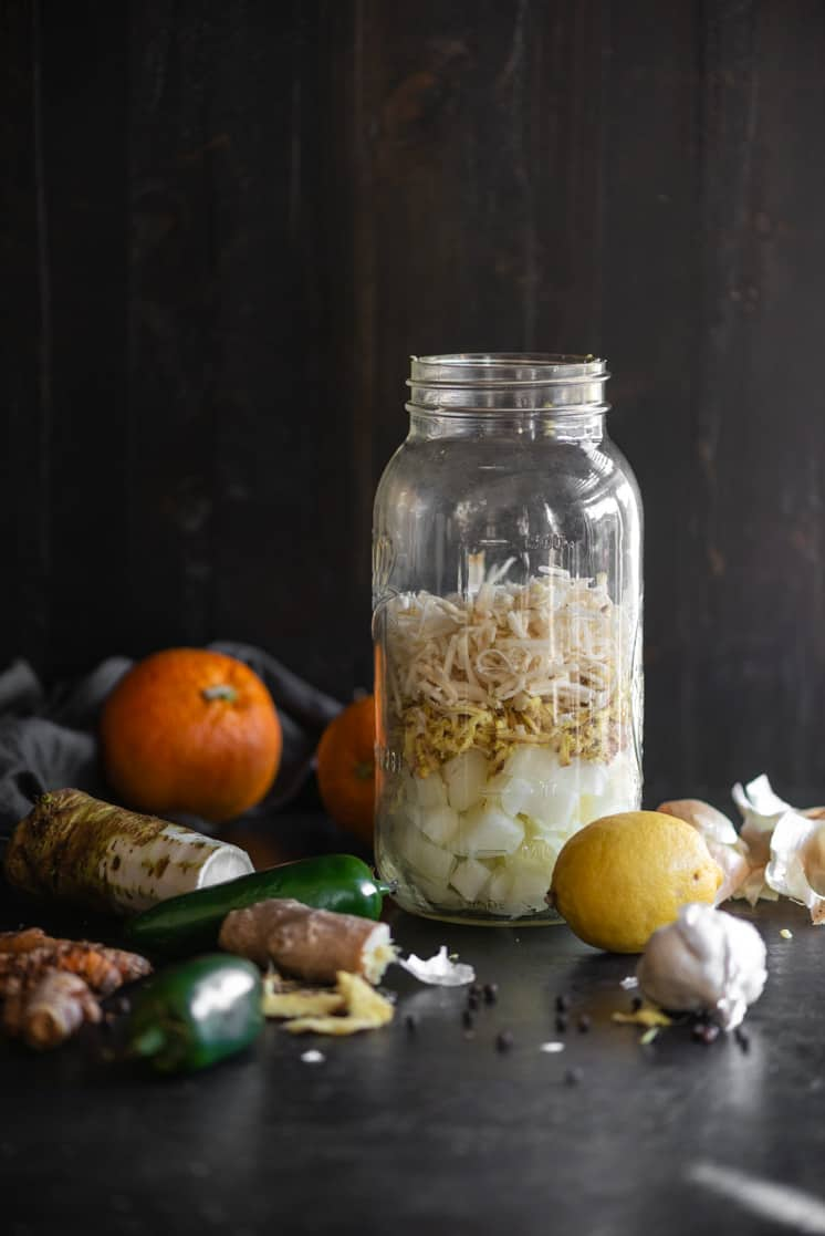 next add the grated horseradish to your jar