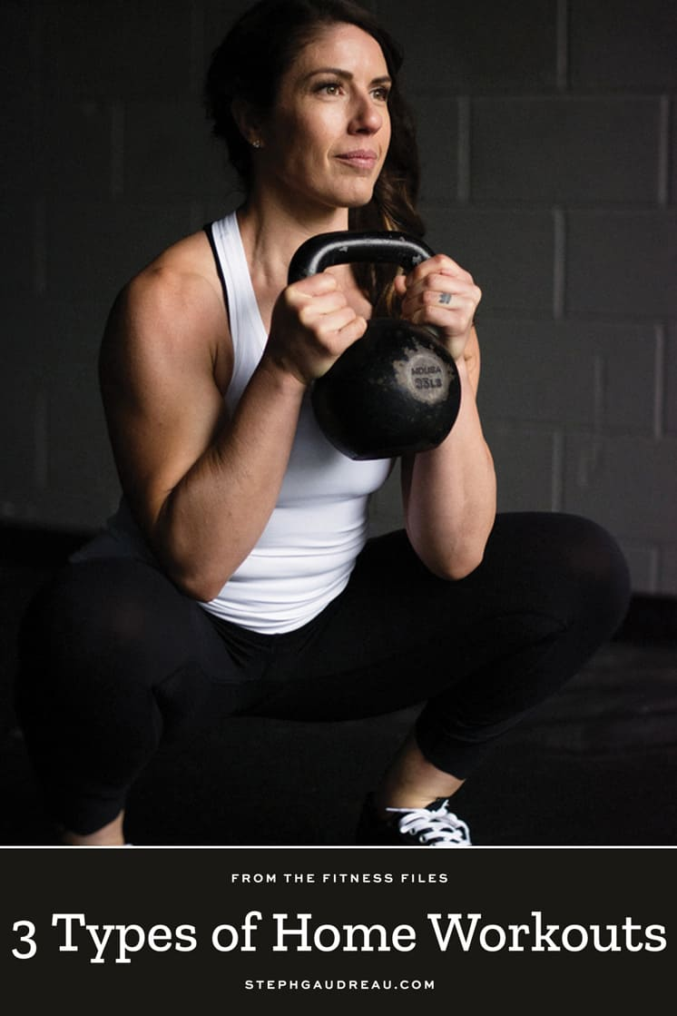 woman with brown hair squatting holding kettlebell at chest level pinterest pin
