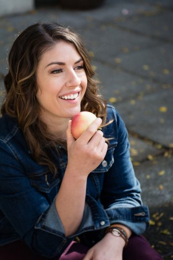 brown haired woman eating apple pinterest pin