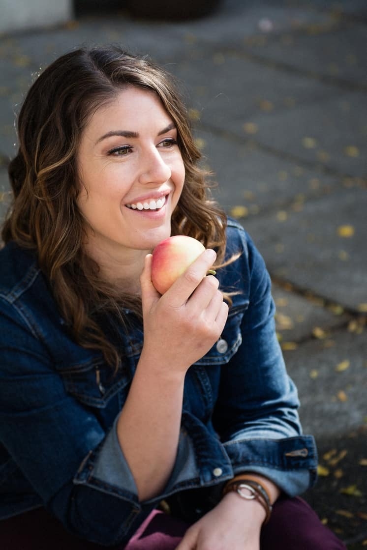 brown haired woman eating apple
