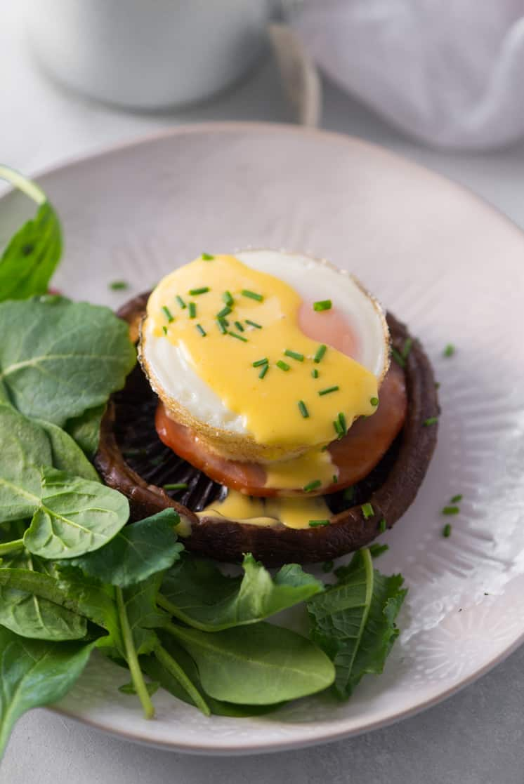 baked egg on top of canadian bacon and portobello mushroom with easy hollandaise sauce